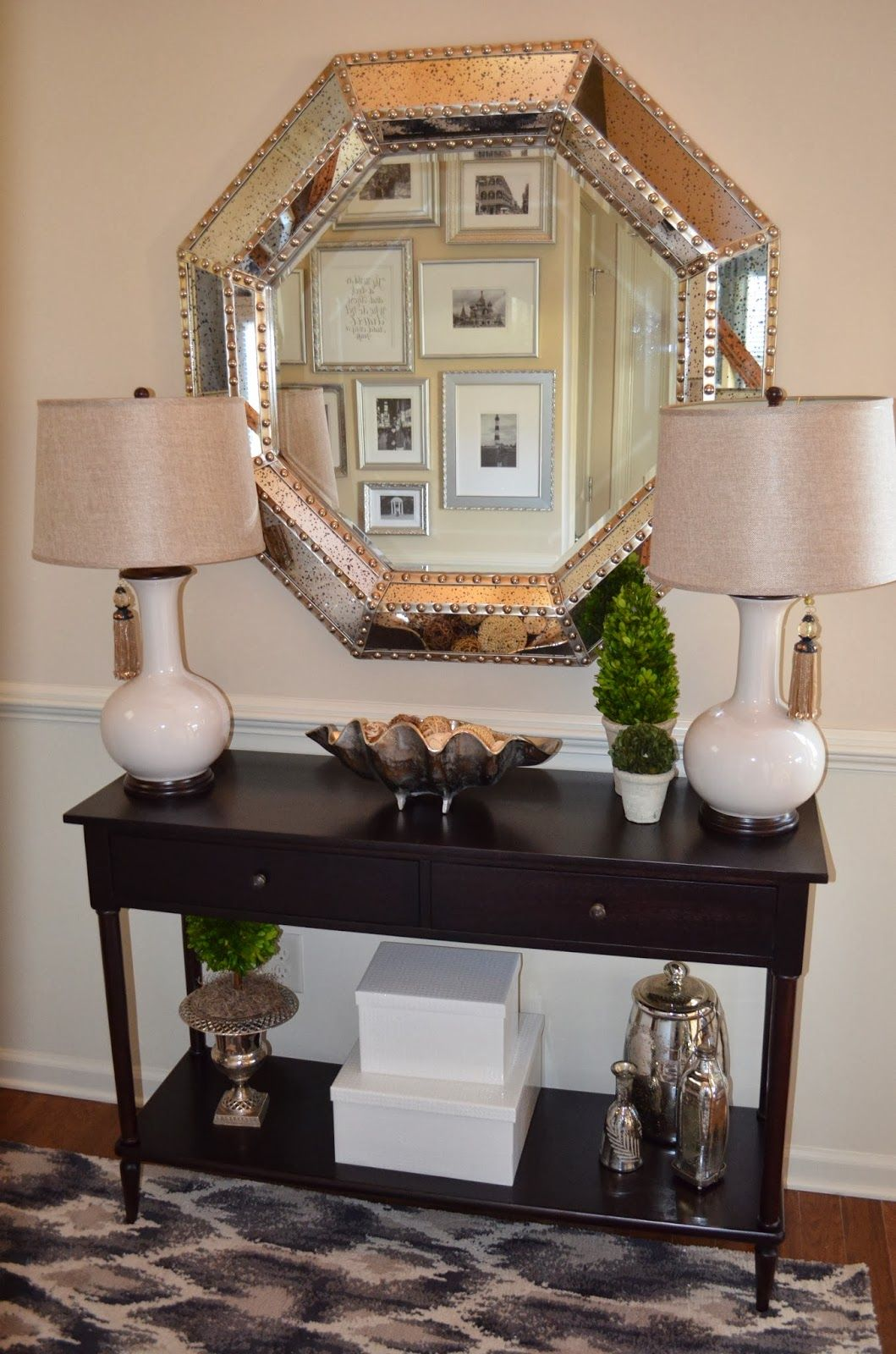 Foyer decor with entryway console table and large silver mirror