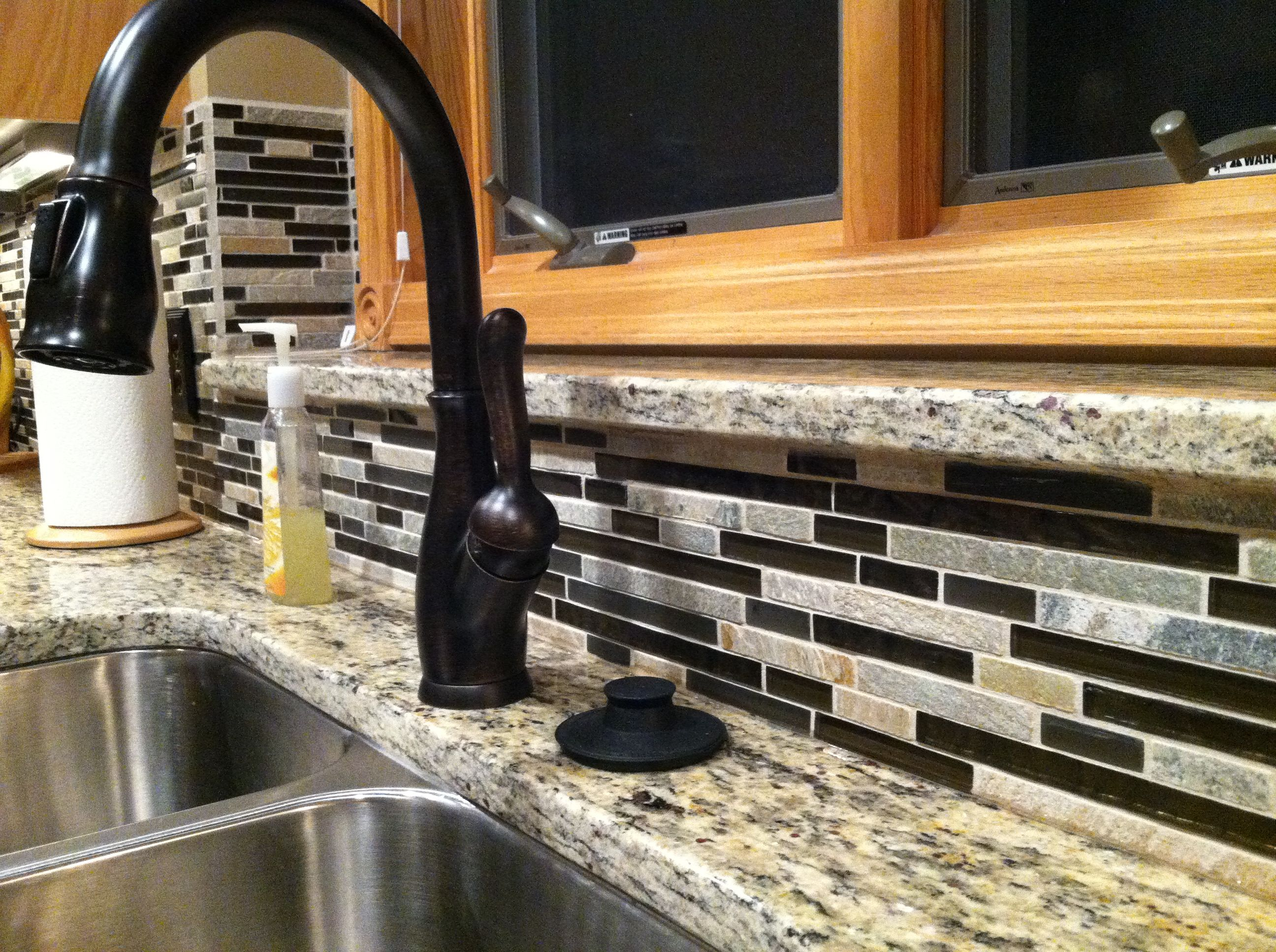 Kitchen Faucets For Granite Countertops Delta Oil Rubbed Bronze Faucet Backsplash Is Glass And
