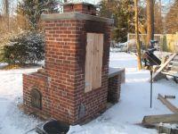 Smoker with wood door. Firebox behind smoker, but no grill ...