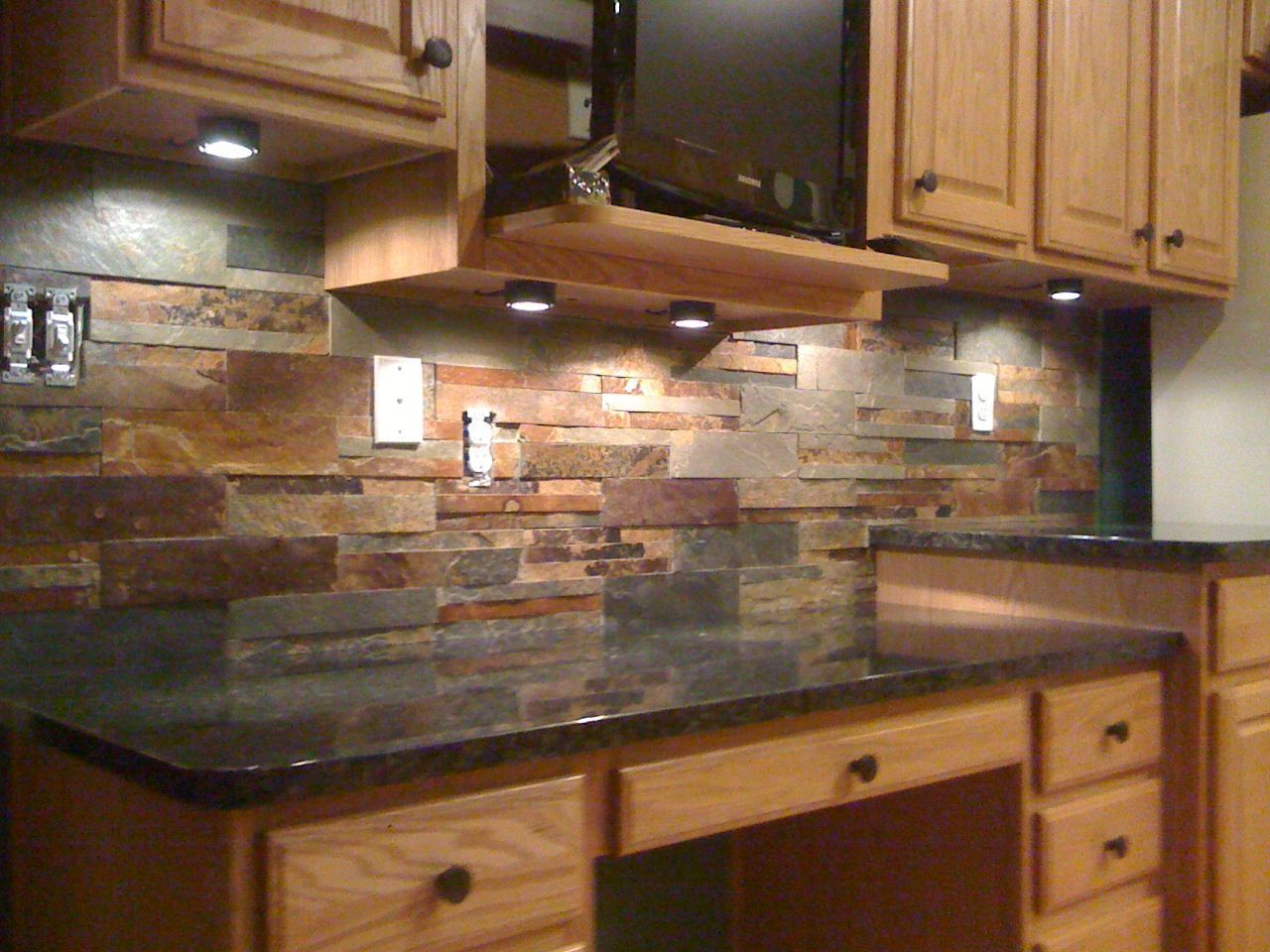 Kitchen Tiles Granite This Natural Slate Tile Backsplash Is Shown With Uba Tuba