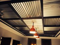 Restored barn lights with corrugated metal ceiling. | Our ...