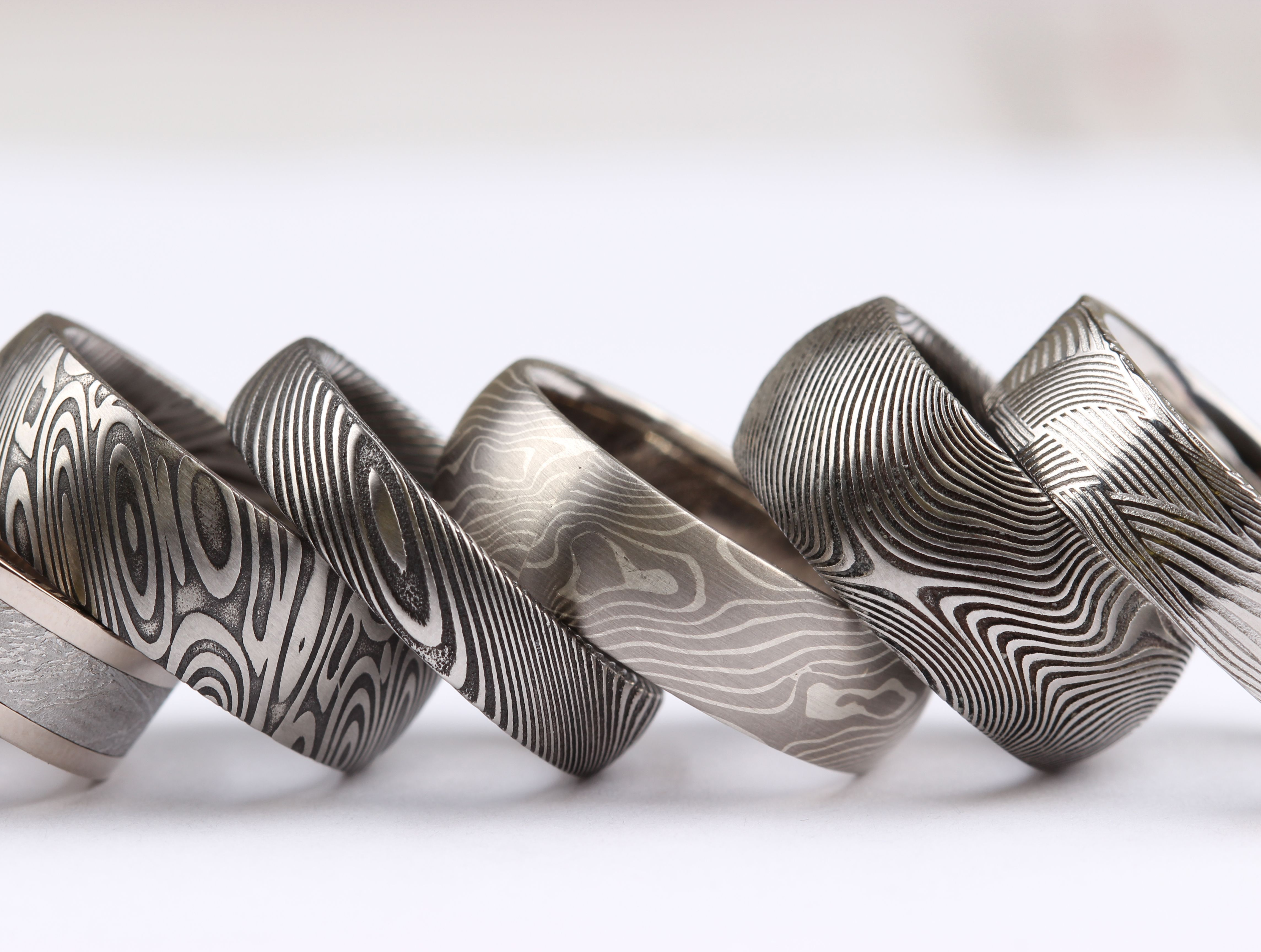 damascus steel wedding bands Damascus Steel Mokume Gane and Meteorite bands By Chris Ploof