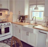 Kitchen white appliances subway tile farmhouse sink wood ...