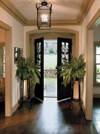 Beautiful antique French doors opening into a simply ...