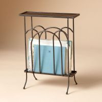WROUGHT IRON MAGAZINE SIDE TABLE -- A slim iron table with ...