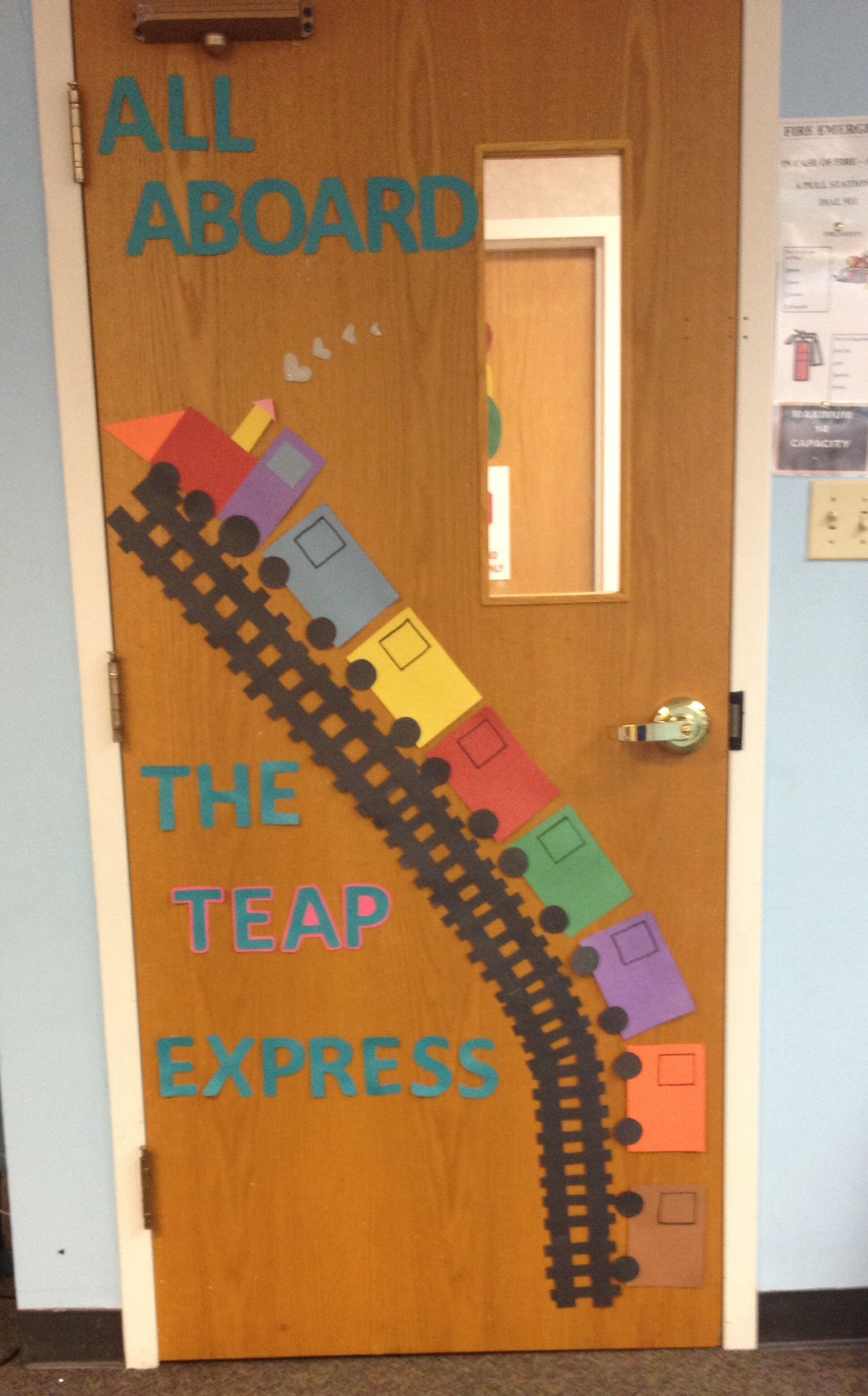 Preschool transportation door decoration. As kids faces to