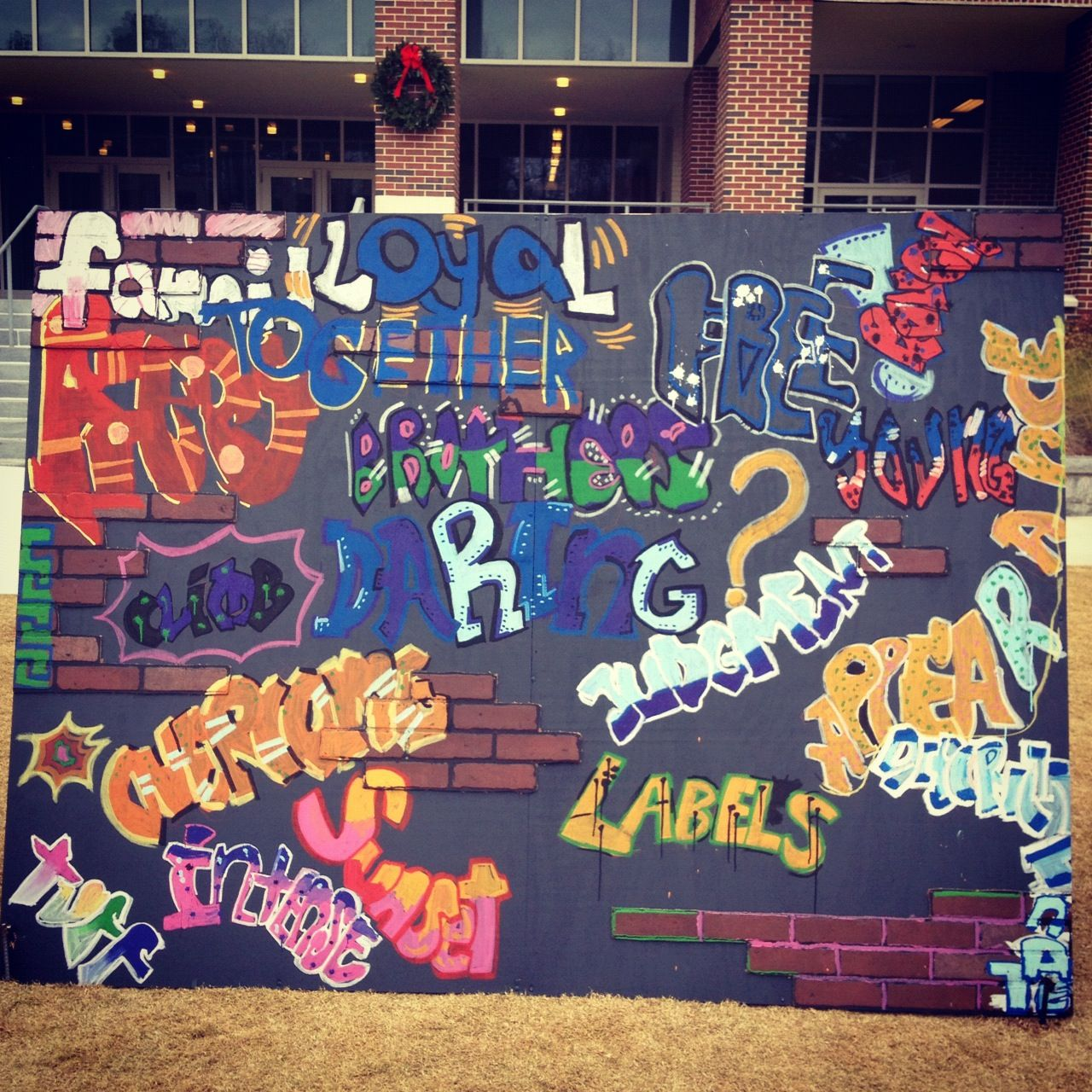 Middle school graffiti wall expresses literary themes from the outsiders