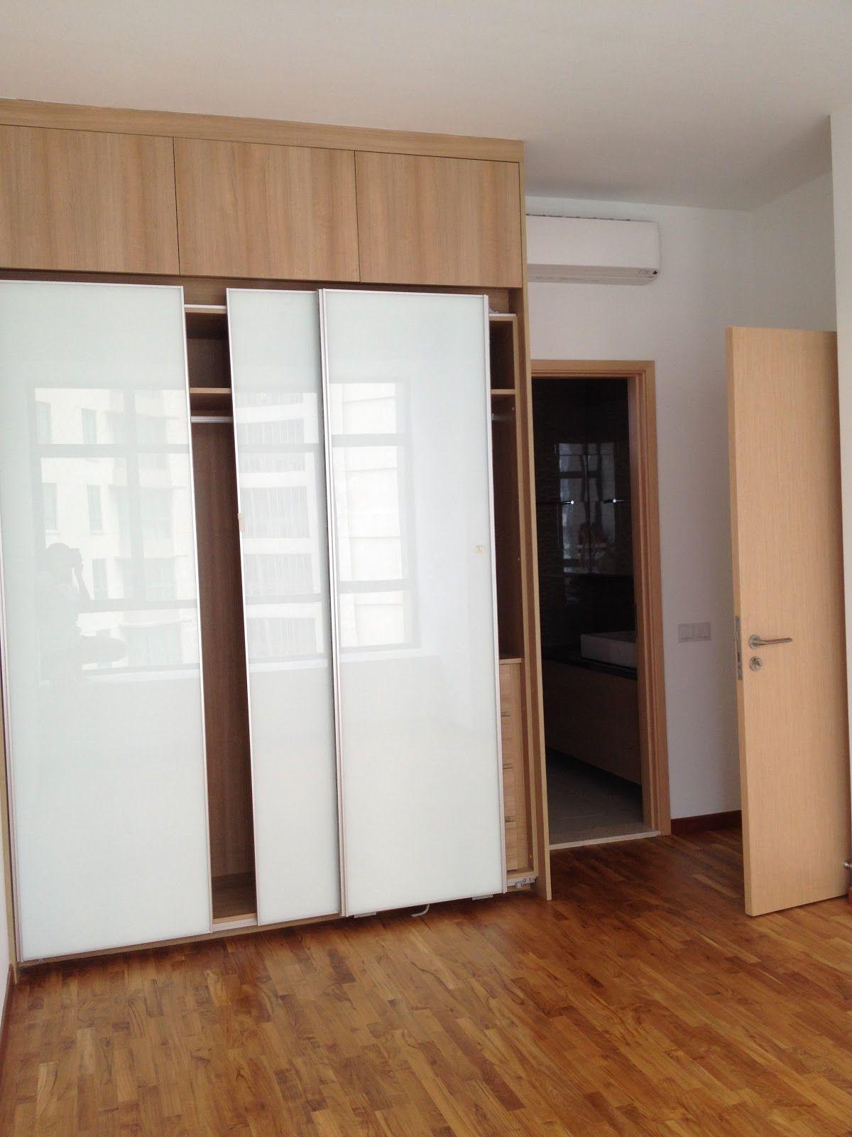Glorious White Glozzy Sliding Doors Built In Wardrobe On