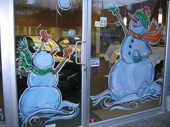 Snowmen playing with snowball window painting