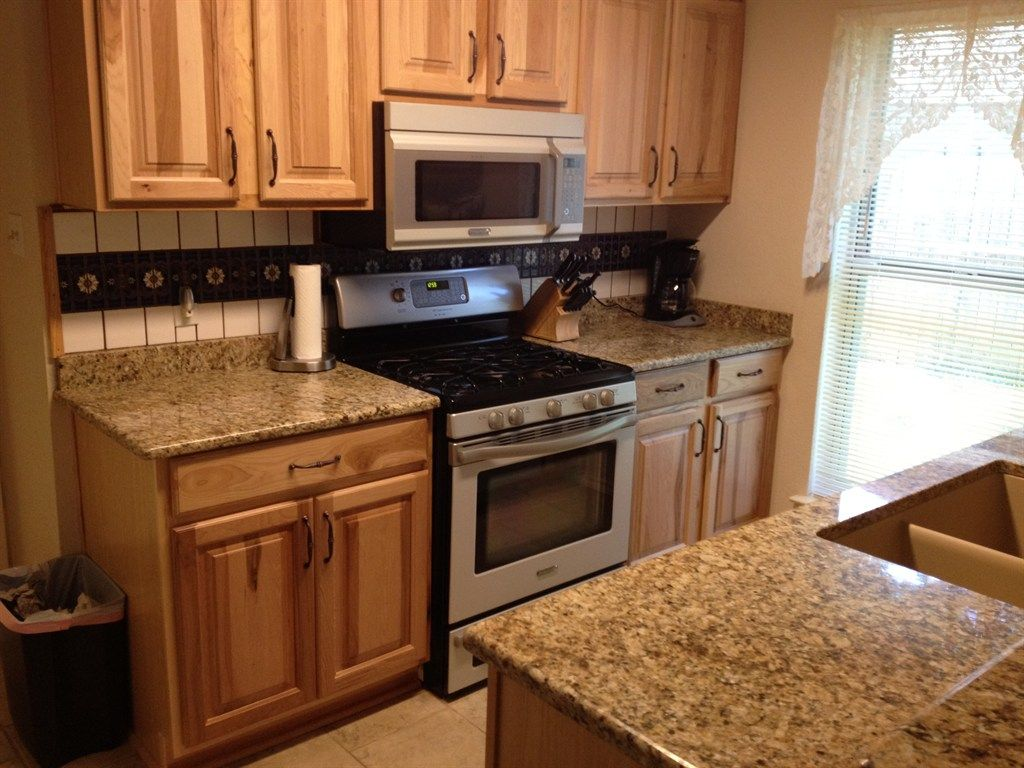 Marble Countertops Austin Honey Oak Cabinets With Black Granite Countertops Google
