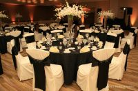 black tablecloths, white chair covers   decorations ...