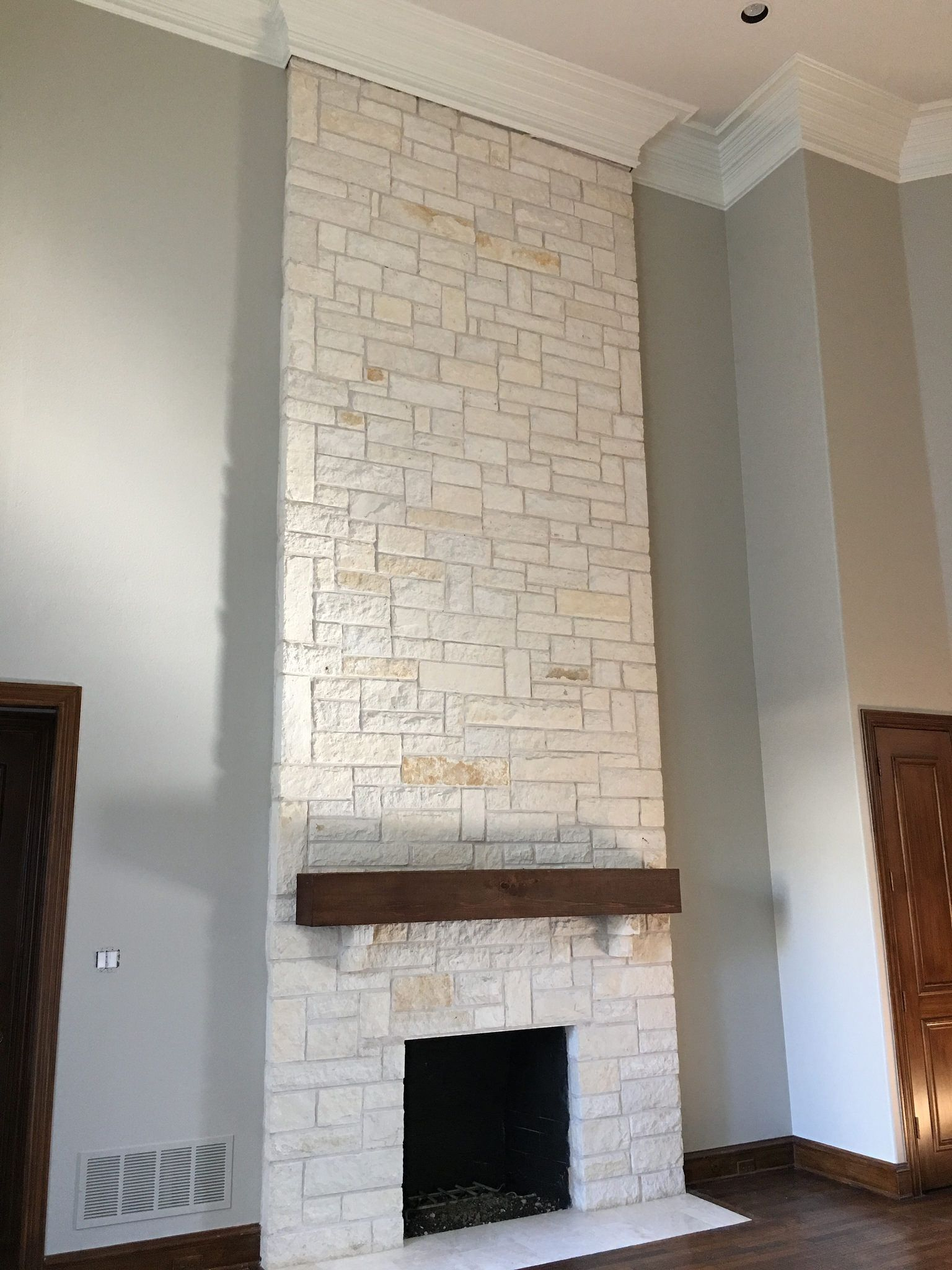White Austin Stone fireplace After photo with Revere