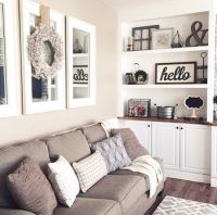 Mirrors above couch with wreath. Open the room up with ...