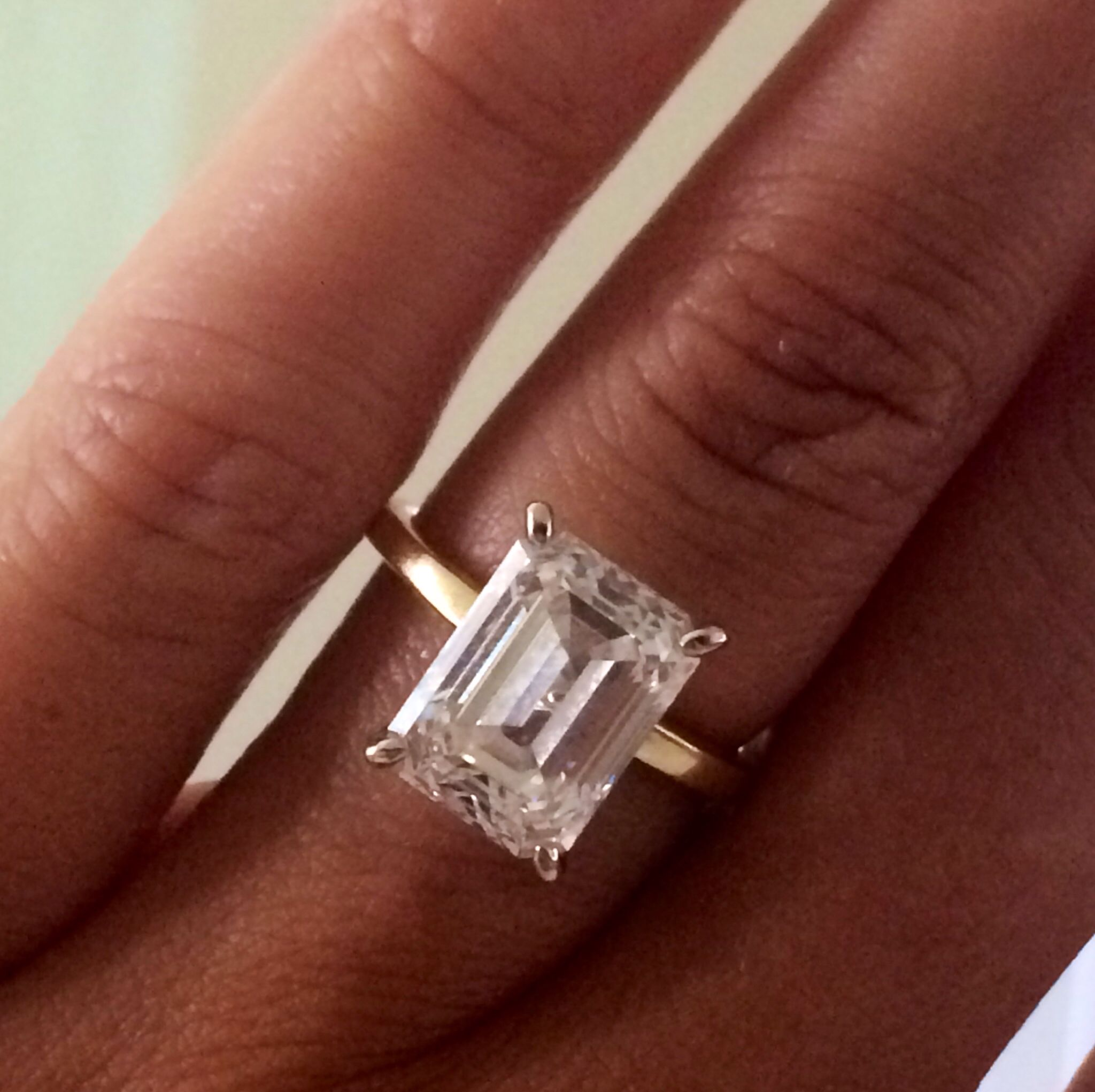 giant wedding ring 4ct or whatever giant rectangle diamond emerald cut thin band this