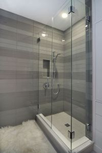 Contemporary shower with striped tile detail by Johnson ...