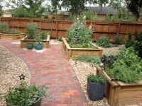 Raised beds with brick patio--far view | Outdoor ...