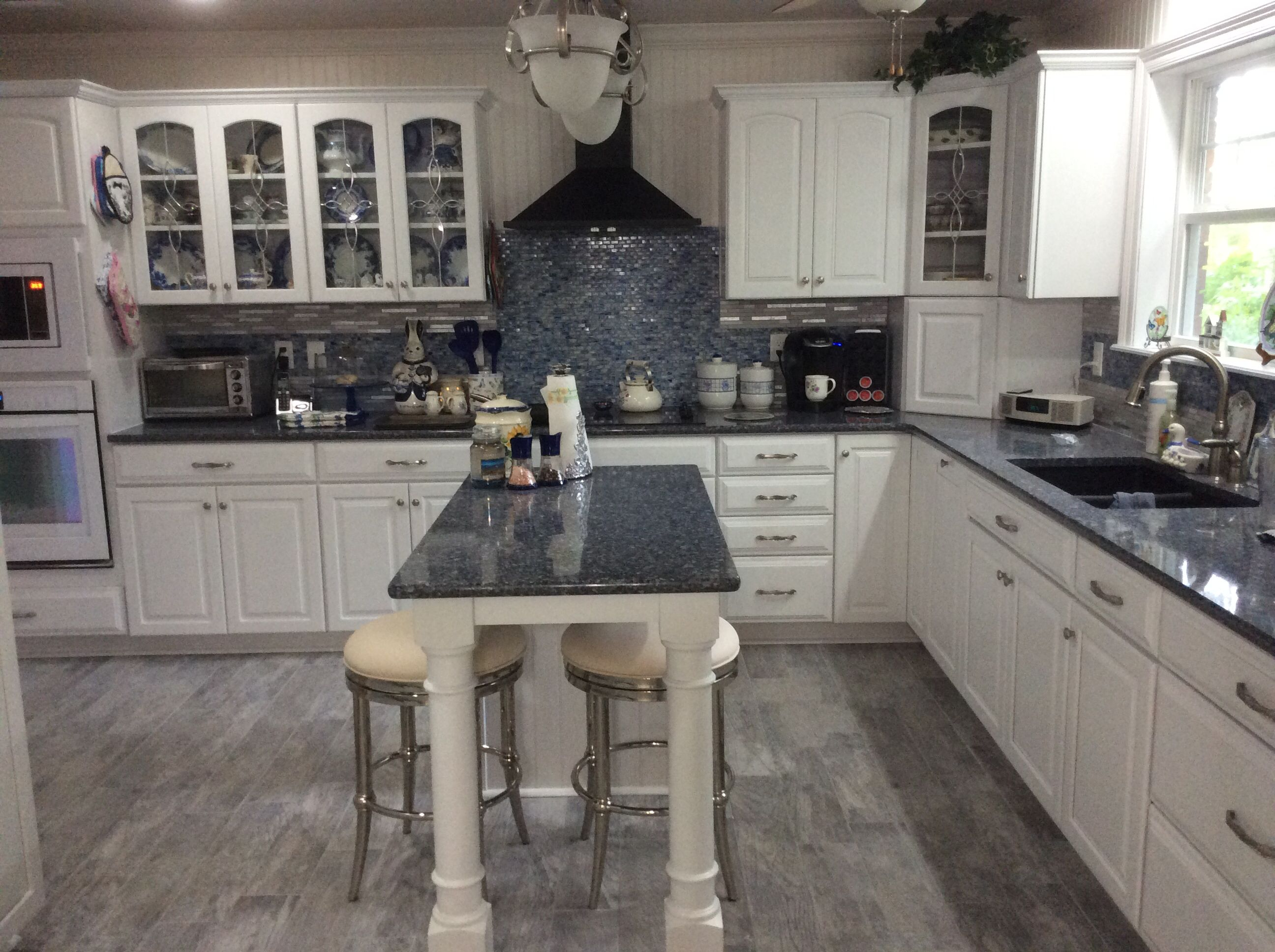 tile kitchen cabinets home depot Blue and white kitchen Cambria Quartz countertop Parys Kraft maid cabinets Home Depot