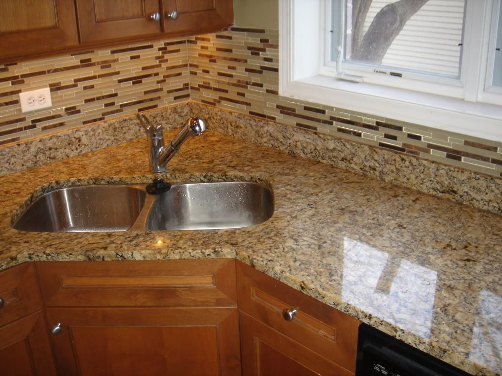 Matching Backsplash To Countertop Giallo Ornamental Granite Countertop And Matching Glass