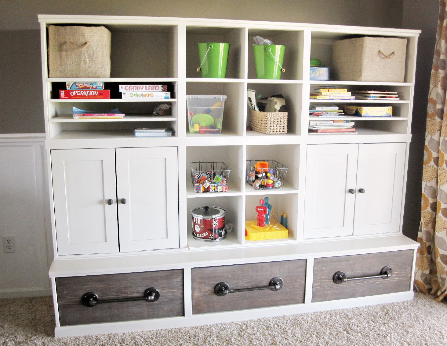 Amazing diy playroom storage plans by ana white com love the pipe handles and