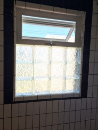 Black and white bathroom remodel. Glass block with awning