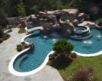 Elaborate Swimming Pool featuring Large grotto, waterfall ...