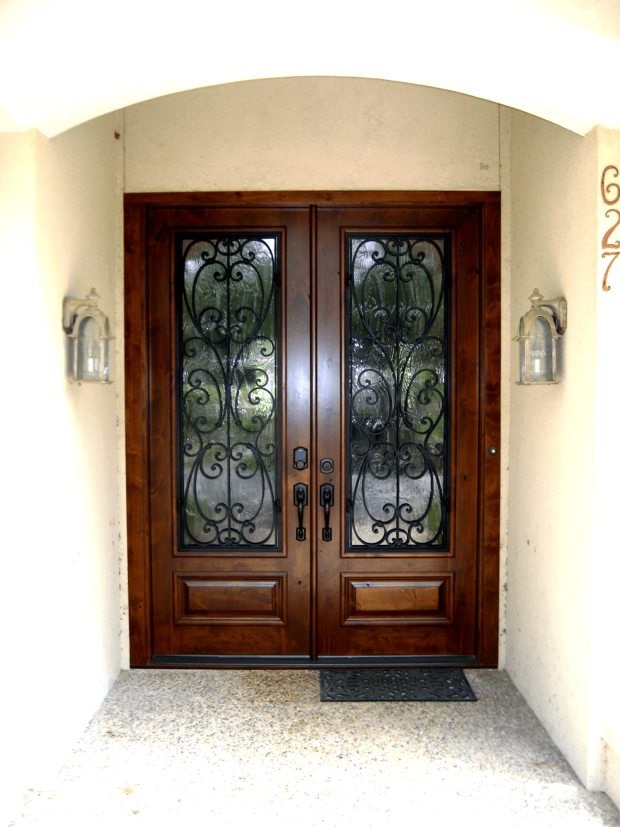 Wood and wrought iron grill double door this front door entry door is sure