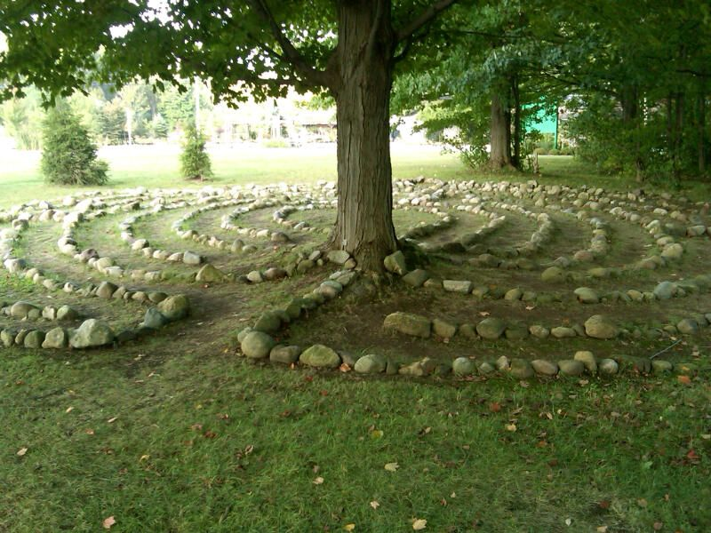 The labyrinth at the Chautauqua Institution lies partly in shade - labyrinth garden design