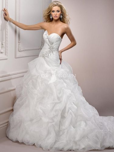 beaded wedding dress Inspiration for Natalie s first wedding gown from Fox Gown caught up skirt