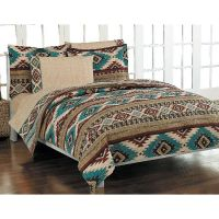 Bedding features a geometric southwest pattern in colors ...