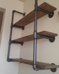 Industrial pipe shelving with reclaimed wood. This unit ...
