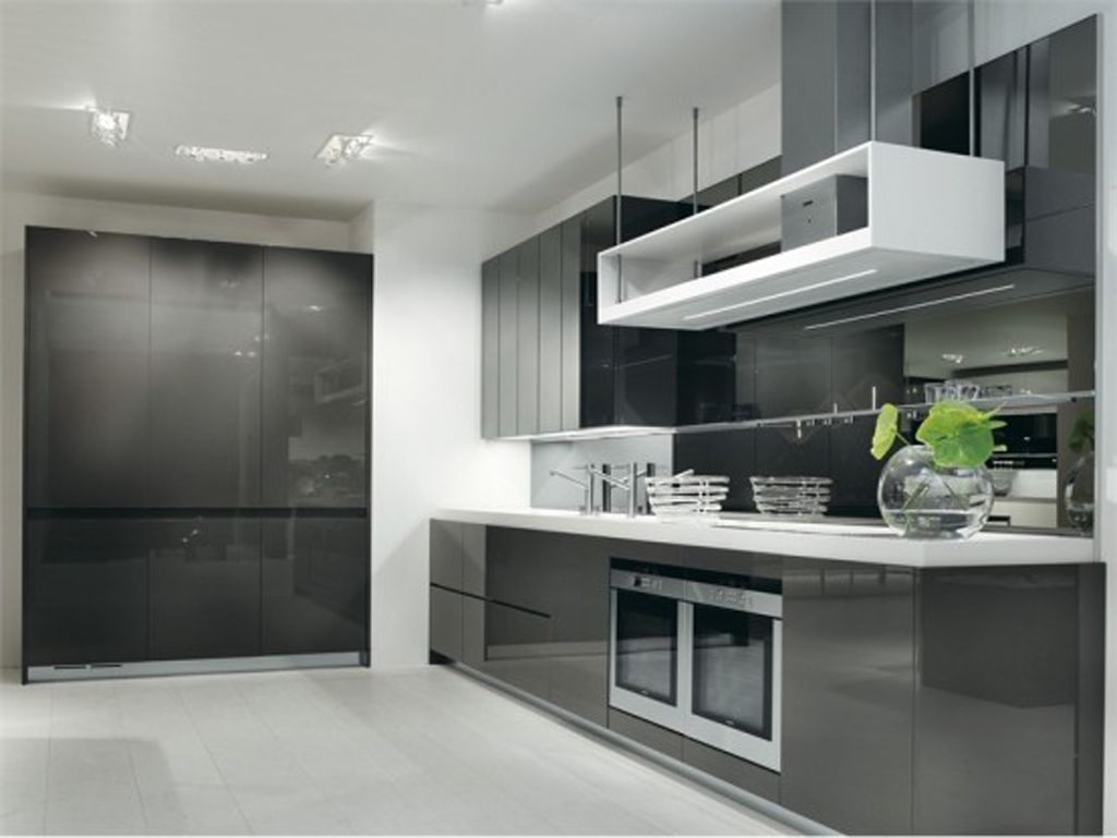 kitchen contemporary kitchen cabinets White Themed Trendy Kitchen Designs with Elegant Black Base Kitchen Cabinet that have White Countertop complete