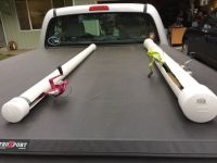 Pvc fishing rod holders. Just used pvc pipe with end caps ...