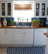 butcher block counter tops in blue and white kitchen ...
