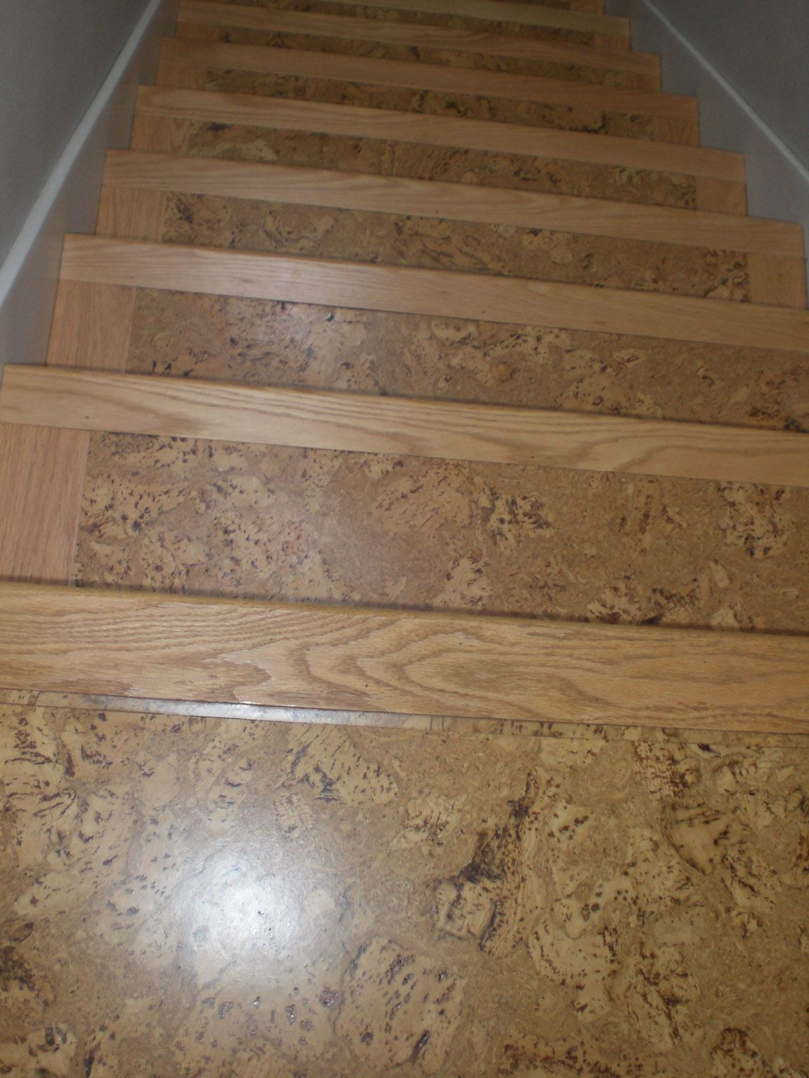 cork flooring kitchen cork on stairs with wooden stair nose pieces
