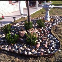 A simple Rock Garden can perk up any front yard. This one ...