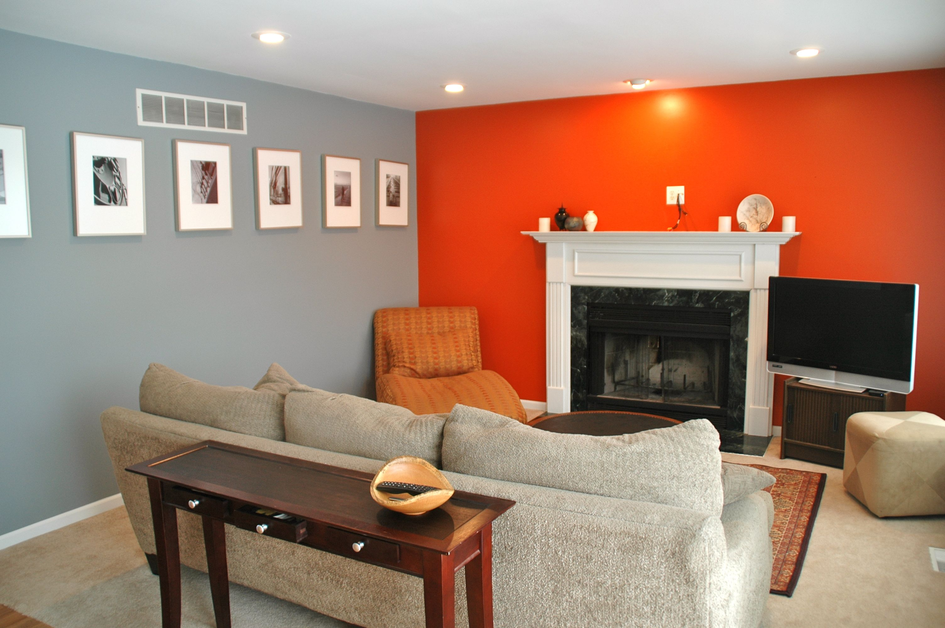 Grey + Orange Living room.