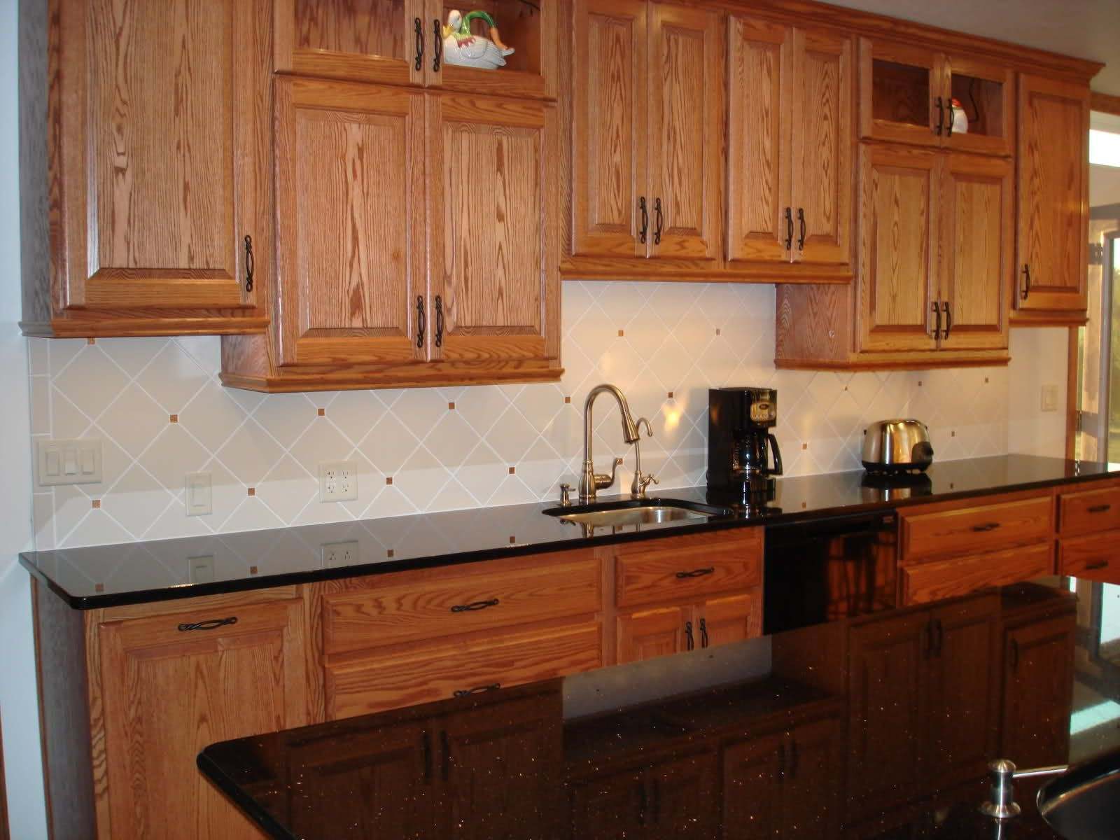 Oak Cabinets Backsplash Backsplash Pictures With Oak Cabinets And Uba Tuba Granite