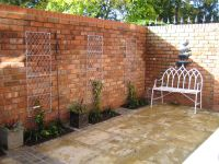 Reclaimed brick walls in a small courtyard garden from a ...