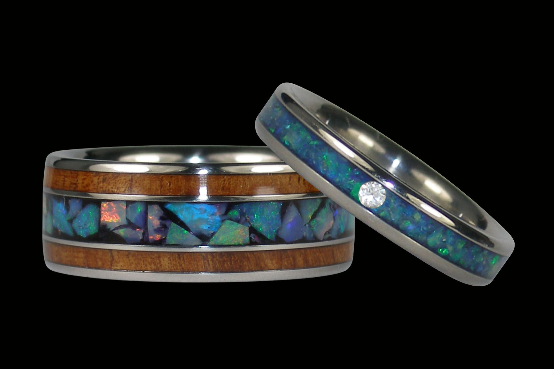 opal wedding ring sets Striking titanium rings set with rare Australian Opal and Koa Wood inlays unique engagement rings or wedding bands Mens wedding band and womens