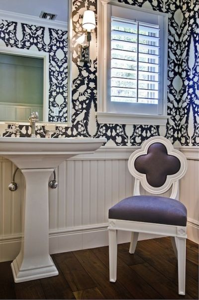 Gorgeous powder room with hardwood floors paired with beadboard half wall below Schumacher ...
