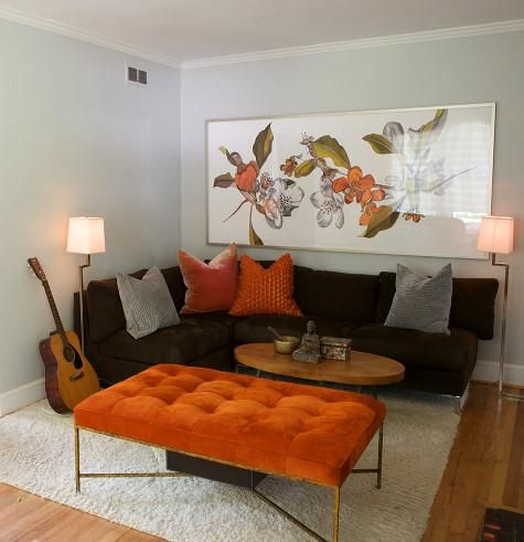 gray walls, brown couch, and pops of color exactly what my living - orange and brown living room