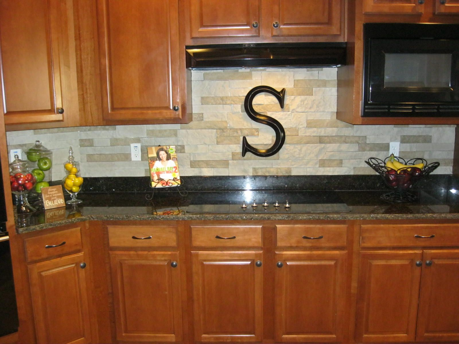 stone backsplash kitchen Our new stacked stone backsplash We used AirStone sold at Lowes very lightweight
