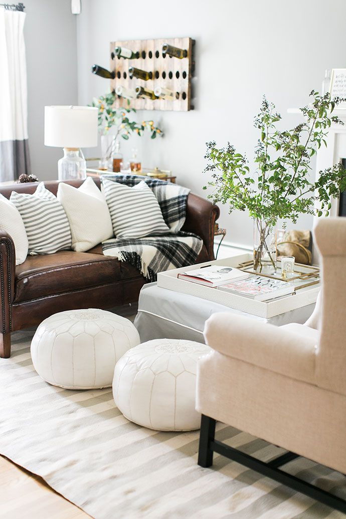 An Editorial Stylist Invites Us Inside Her Beautiful Coastal Home - poufs for living room