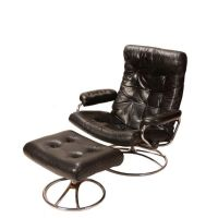 This is a very comfy leather Stressless recliner by ...