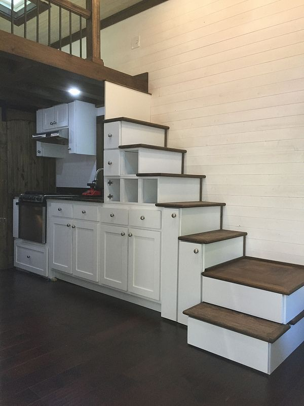cabinets, stairs with flip up steps and very narrow stairs Each - under stairs kitchen storage