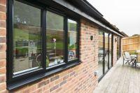 Matching black aluminium windows and doors | Home ...