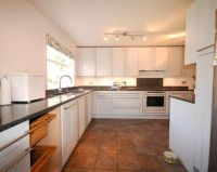 photo of beige brown white kitchen with floor tiles ...