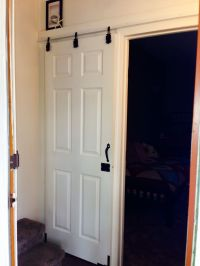 DIY sliding door.....cheap-o style that I did using $6 ...