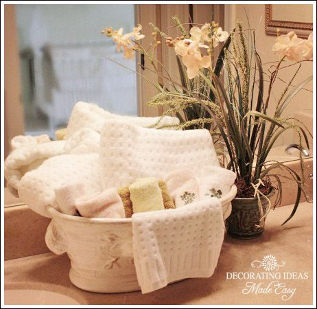 Bathroom Decorating Ideas - use a pretty floral container to hold - bathroom towel decorating ideas