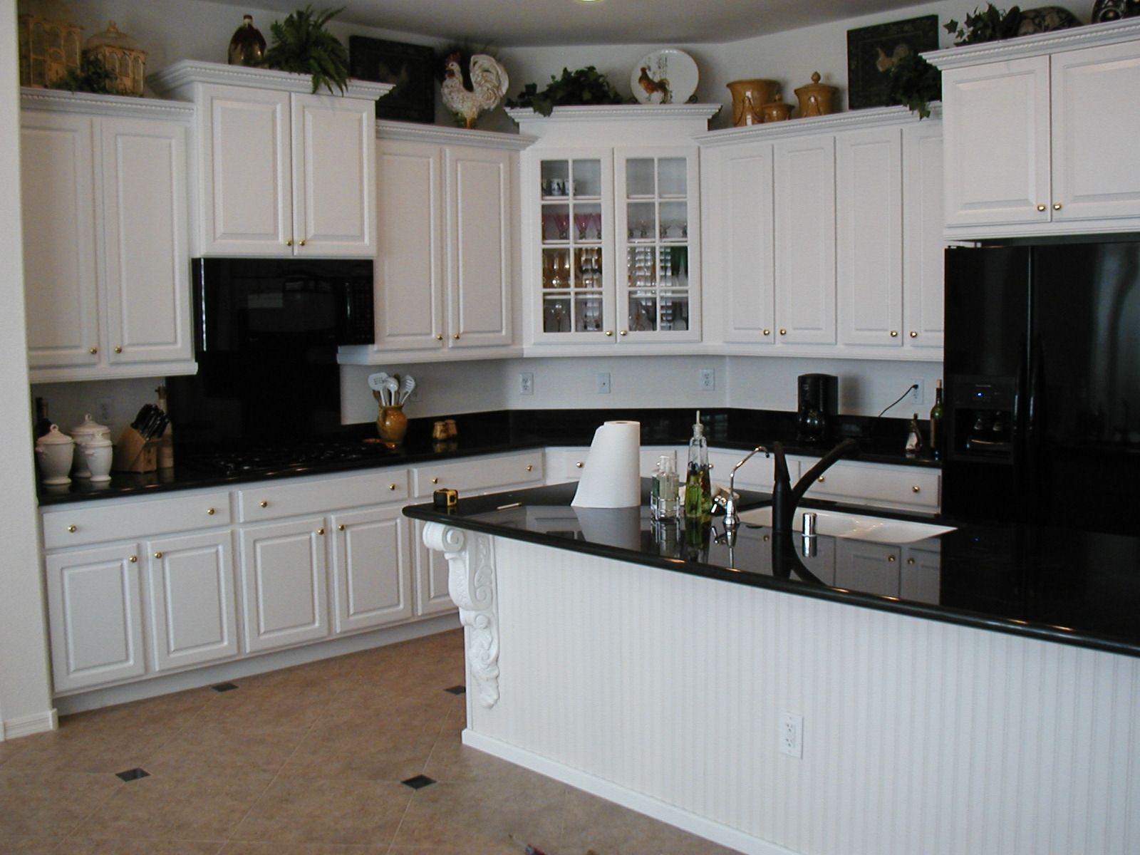 White kitchen with black appliances and black countertop